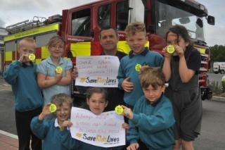 Firefighters visit Castle Mead School for road safety week