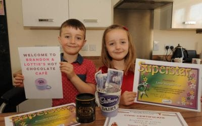 Young siblings help the homeless by turning home into pop-up café